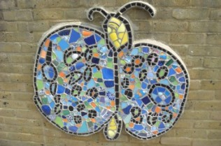 Mosaic butterfly on the playground wall
