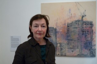 Glenys Johnson in front of one of her works