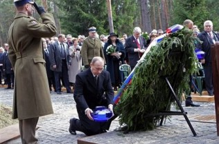 2010. Vladimir Putin leaves a wreath at the memorial to the Polish troops massacred at Katyn in 1940.