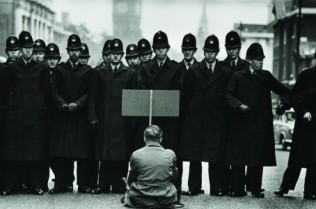 A-lone-anti-war-protester-confronts-police-in-Whitehall-during-the-Cuban-Missile-Crisis-London-1962-460x300