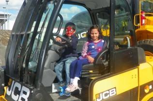 Children enjoying vehicle display