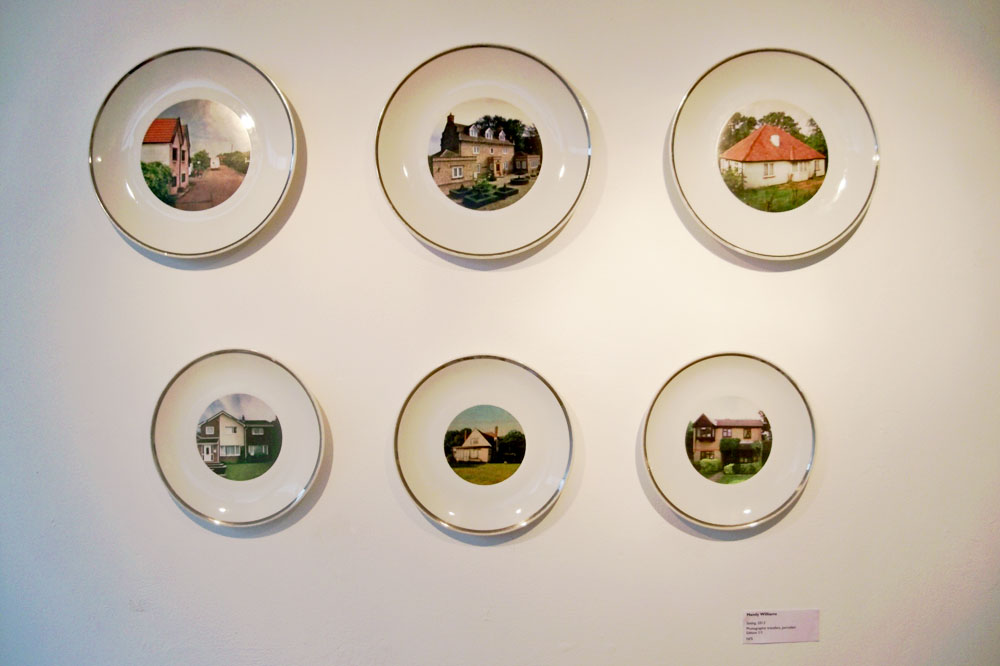 Photographic transfers on porcelain of homes.