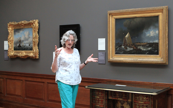 Judy teaches a group of students about the works of art in the gallery on July 9.