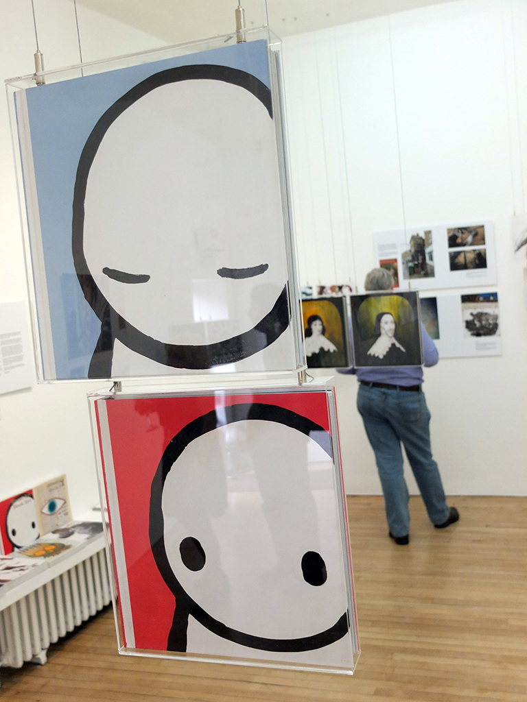 Books illuminated by Stik and System at Street Art Book Art show.  Photo by APHQ