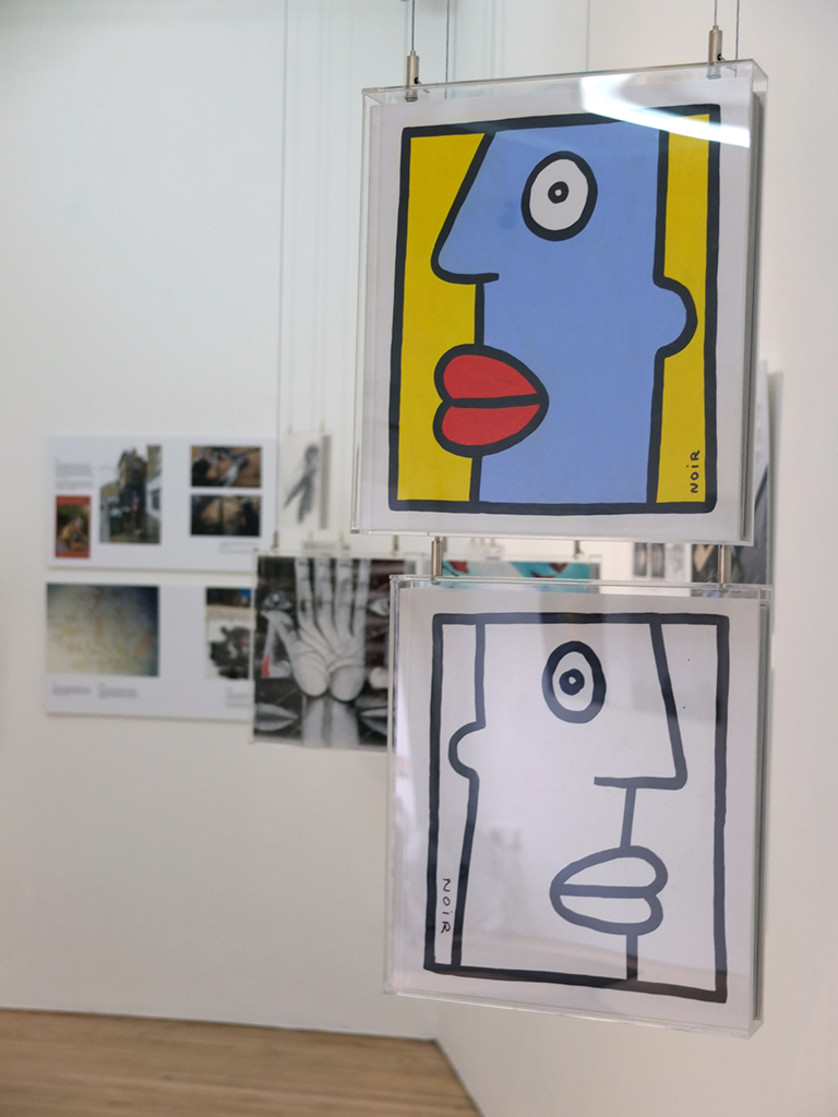 Books painted by Thierry Noir and RUN for the Street Art Book Art show