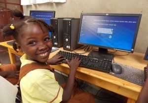 A-pupil-at-Jesus-and-Mary-School-in-Gros-Morne-Haiti-learning-how-to-type-using-the-computers-installed-by-UCDVO-and-Camara-in-July-2014.-Photographer-Beth-Ratke-