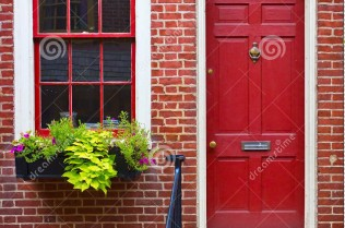 colorful-red-door-brick-wall-16735256