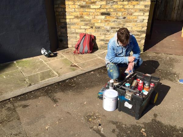 David sorting through his paints, photo courtesy of Liz Vanderau